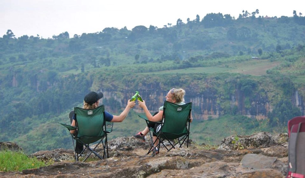Cheers at Moses Campsite, Sipi Falls Uganda during your self drive safari