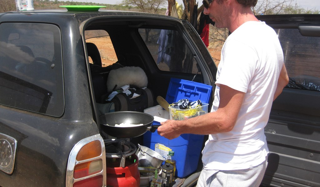 Baking pancakes along the way to Mombasa on a self drive safari in Uganda.jpg