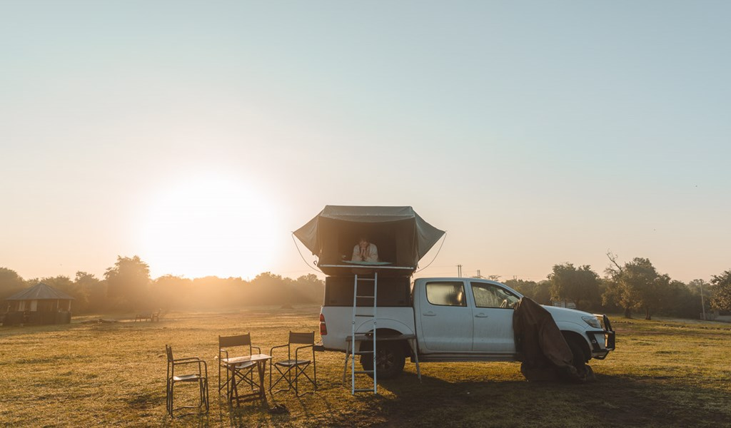 Toyota Hilux with roof top tent, at Lake Mburo campsite